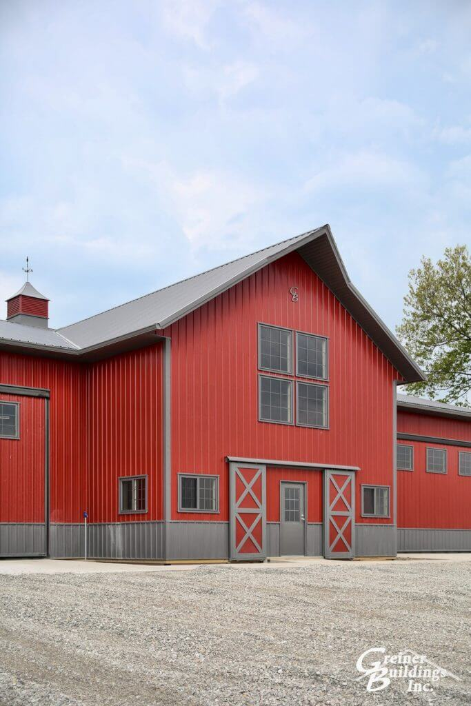 Award Winning Post Frame Machine Shed Red with Smoke wainscot and roof